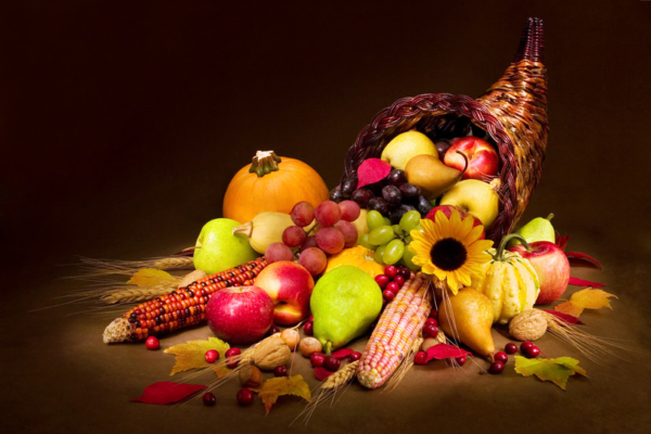 A cornucopia overflowing with fruits, vegetables, and grains.